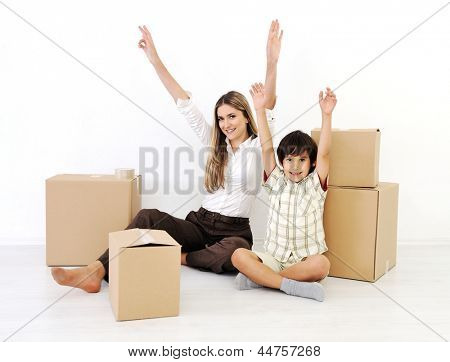 Young women and little boy with hands up