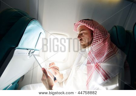 Arabic businessman working on tablet computer