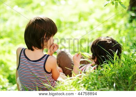 Happy two little boys outdoors in nature having good time