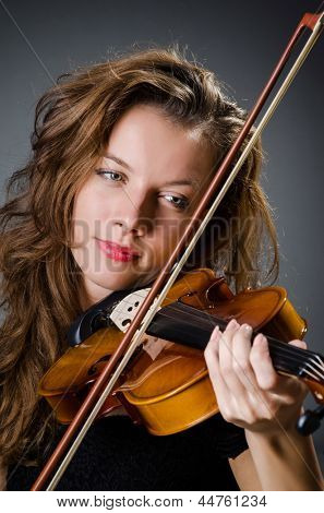 Attractive woman with cello in studio