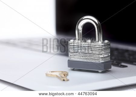 Laptop Computer With Lock and Key Symbolizing Protection and Safety
