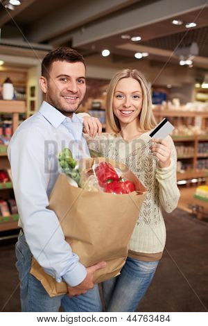 Smiling couple with a credit card