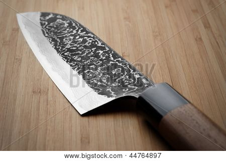 Grungy image of damascus steel japanese kitchen knife