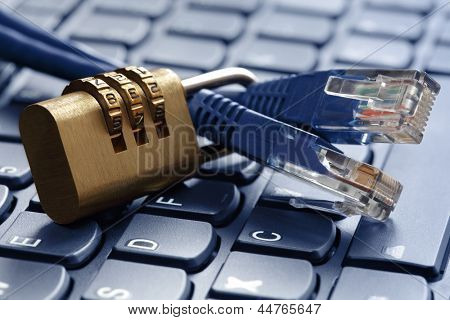 Internet security and network protection concept, padlock and connection plug on laptop