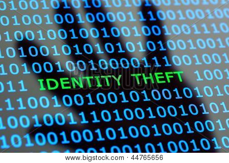 Internet identity theft on a digital tablet with reflection of hackers hand concept for online digital crime