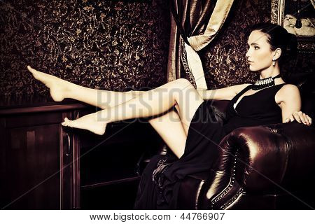Beautiful young woman in a  luxurious classic interior. Vintage style.