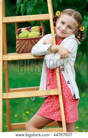 Gardening, orchard - lovely girl with ripe fruits in basket