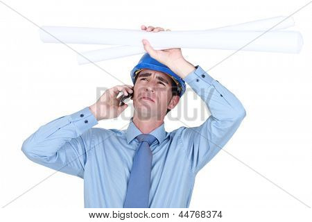 Architect receiving bad news over the phone