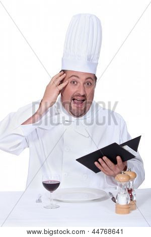 Clueless cook sitting at a table
