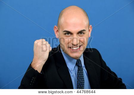 businessman in suit tight-fisted