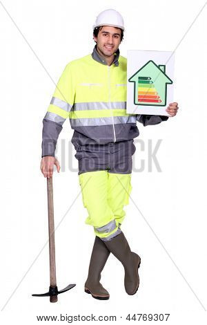 handsome heating engineer with hand resting on pickaxe