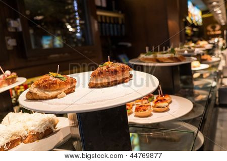 Traditional basque pinchos on a plate in restaurant