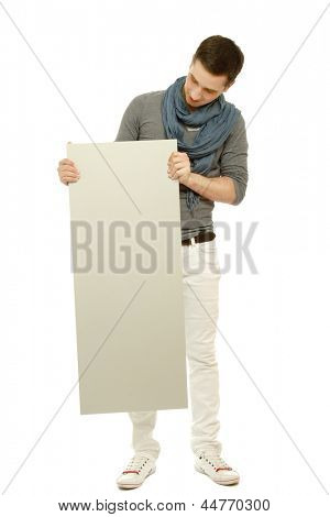 A handsome man holding a blank, isolated on white background