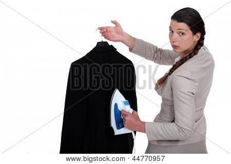 Woman ironing a suit