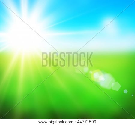 Beautiful background from blurred field with sky and rays of sun