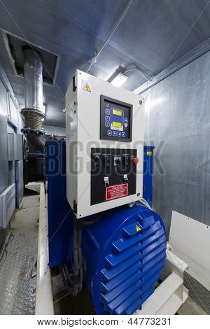 Modern powerful diesel generator for backup power with automatic switching.