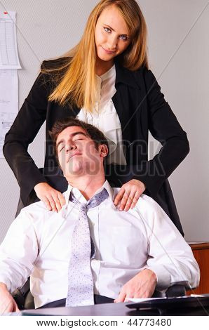 young businesswoman is making head massage to her teammate