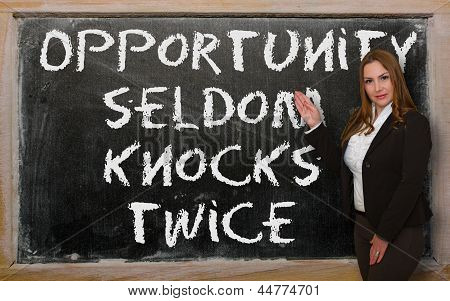 Teacher Showing Opportunity Seldom Knocks Twice On Blackboard