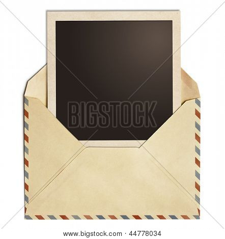 old air post envelope with polaroid photo frame isolated on white