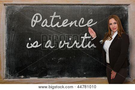 Teacher Showing Patience Is A Virtue On Blackboard