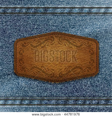 Ornate leather label with copyspace on denim background - eps10