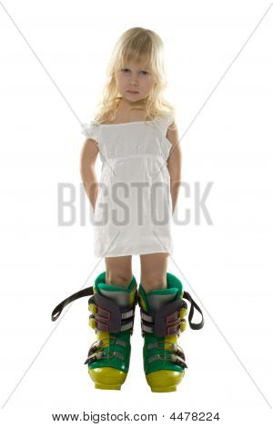 Little Girl In White Dress And Big Ski Boots