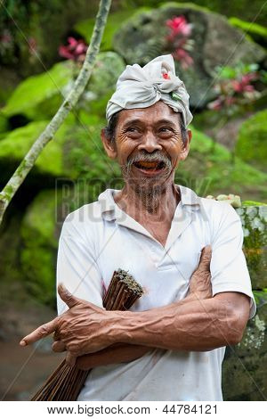 BALI - JANUARY 23: Portrait of male worker with headscarf on January 23, 2012 Bali, Indonesia.