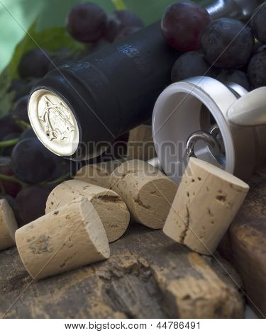 dark grapes with corks,