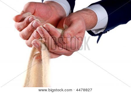 Businessman Trying To Hold Sand