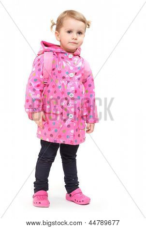 Little girl in dressed in the raincoat.