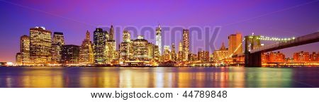 New York City panorama with the Brooklyn Bridge and the Financial district from across the East River.