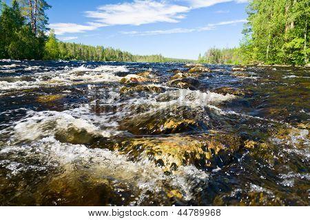 Close-up shot of rapids on the Pistojoki river in Karelia, Russia