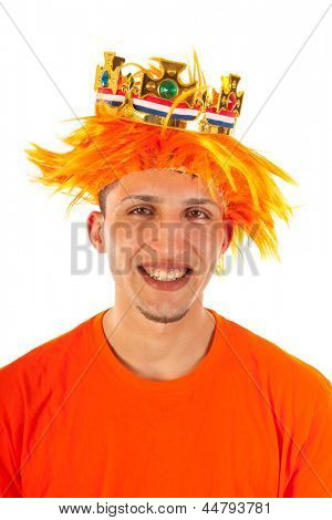Young man celebrating kings day in Holland isolated over white background