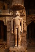stock photo of jain  - Rockcut Statue of Jain thirthankara in rock niches near Gwalior fort - JPG