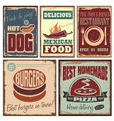 stock photo of junk  - Vintage style tin signs and retro posters - JPG