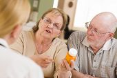 picture of prescription  - Doctor or Nurse Explaining Prescription Medicine to Attentive Senior Couple - JPG