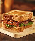 foto of tomato sandwich  - BLT bacon lettuce tomato sandwich on a napkin - JPG