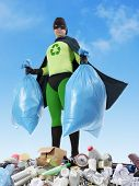 Eco superhero holding two plastic bags full of domestic trash standing on garbage heap - waste segre