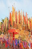 Thai New Year - Songkran. Colorful multicolored flags and pennants adorn a special bamboo tower