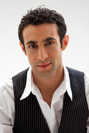 image of arab man  - Handsome male wearing a white shirt and black pinstripe vest isolated - JPG