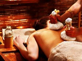 picture of panchakarma  - Woman having Ayurveda massage with herbal ball - JPG