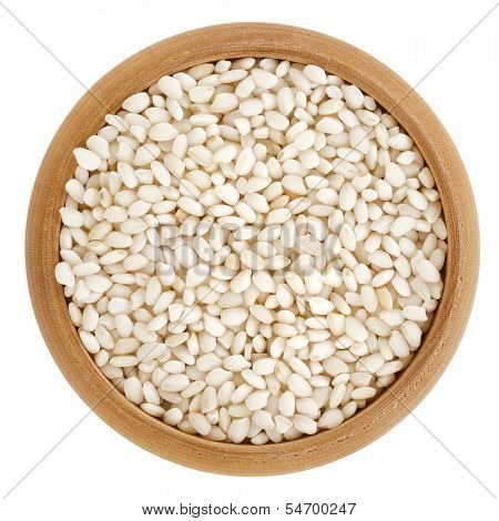Arborio Grain Rice in wooden bowl top view surface  isolated on white background