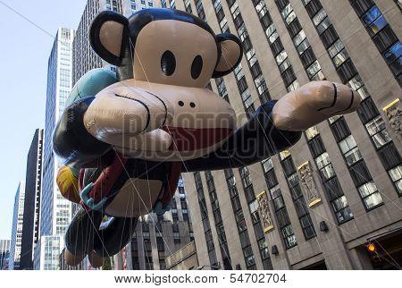 Curious George balloon along Sixth Avenue