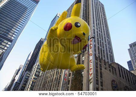 Pikachu balloon passing Radio City Music Hall