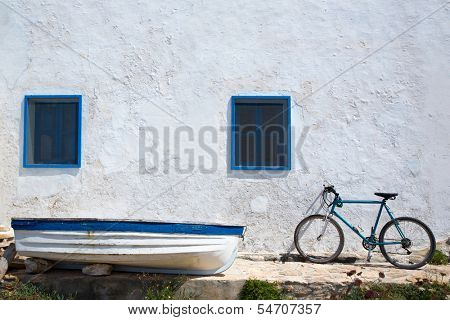 Mediterranean boat bicycle and white wall in white and blue at Balearic Islands