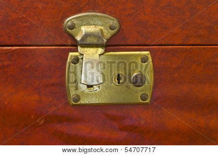 Unlocked Brass Latch On Vintage Luggage