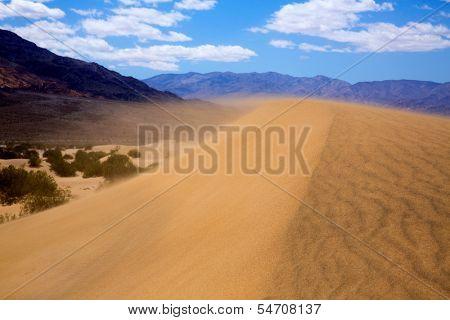 Mesquite Dunes desert in Death Valley wind sand storm detail on dune tip