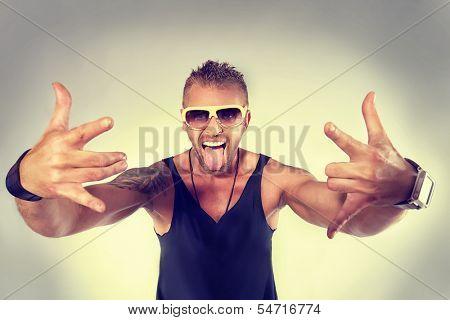 Expressive modern guy posing at studio.