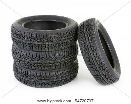 Set of four winter car tyres shot on white