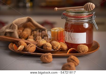 Honey And Walnuts On Table